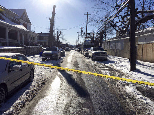 Crime scene tape closes off the scene of a shooting where an officer was killed in Harrisburg, Thursday, Jan. 18, 2018.