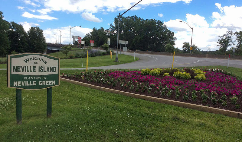 A triangular flower bed planted by Neville Green volunteers at the ramp leading on and off of Interstate 79.