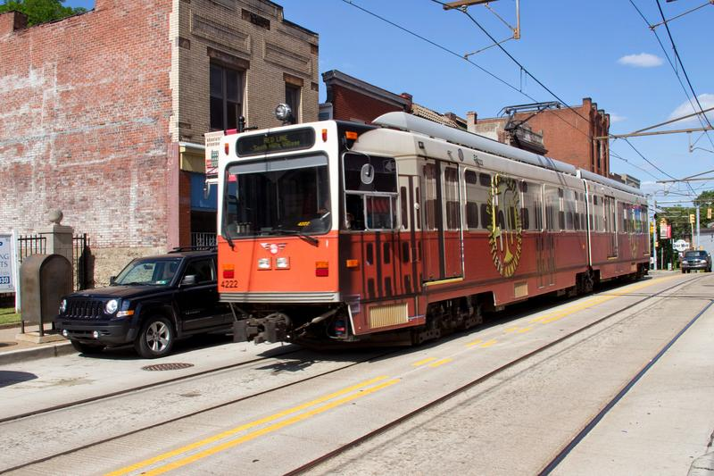 A Red Line T to South Hills Village rides along Warrington Avenue in June 2014. The cars were decorated for the 50th annivesary of Port Authority of Allegheny County.