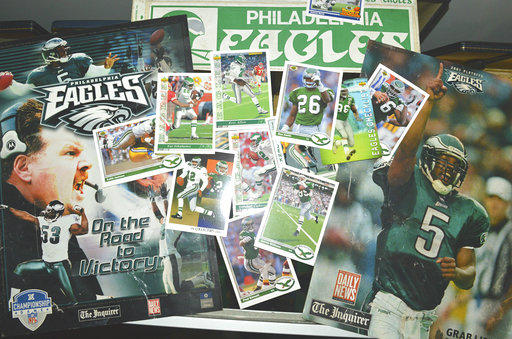 The Pennsylvania Treasury Department opened its unclaimed property vault Wednesday, Jan. 17, 2018, to show commemorative posters, stickers and trading cards featuring Philadelphis Eagles players and former coach Andy Reid.