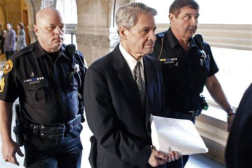 Dr. Robert Ferrante, center, is escorted by Allegheny County Sheriffs deputies to court during jury selection for his trial on homicide charges in the 2013 killing of his neurologist wife, Dr. Autumn Klein, with cyanide in Pittsburgh on Oct. 23, 2014.