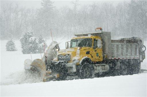 A Pennsylvania Department of Transportation snow plow works to clear an Interstate 81 off ramp during a blizzard in Harrisburg, Pa.