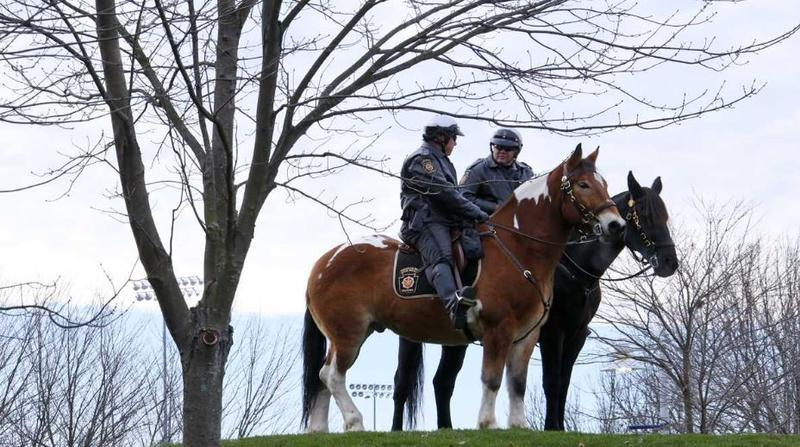 Pennsylvania State Police on horses outside of Beaver Stadium before an NCAA college football game between Penn STate and the Michigan State in State College, Pa.