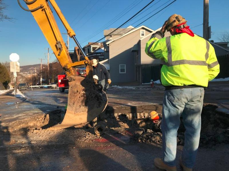 Crews work to repair a water main break at Penn Avenue and Fisk Street, on Friday, Jan. 19, 2018.
