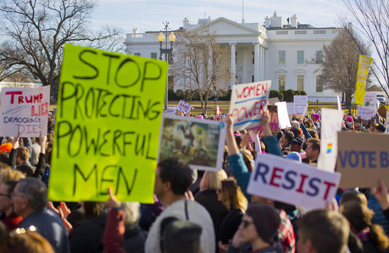 Women's March demonstrators walk past the White House on Saturday, Jan. 20, 2018. On the anniversary of President Donald Trump's inauguration, protestors around the world denouncing his views on immigration, abortion, LGBT rights, women's rights and more.