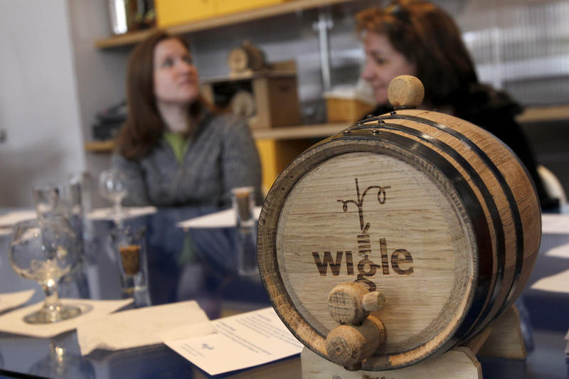 Patti Tavelli, left, and Kelly Smith talk during the tasting session after a tour of the distillery at Wigle Whiskey in Pittsburgh on Saturday, Feb. 11, 2012. Wigle Whisky's owners are semifinalists for a James Beard Award.