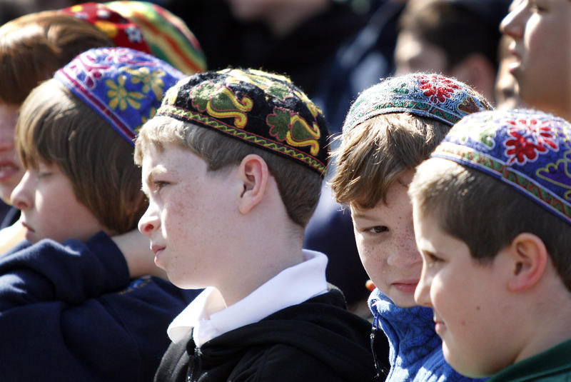 Students at the Community Day School listen to the speakers during the groundbreaking ceremony of a memorial to commemorate victims of the Holocaust in the Squirrel Hill neighborhood in Pittsburgh on Thursday, April 19, 2012.