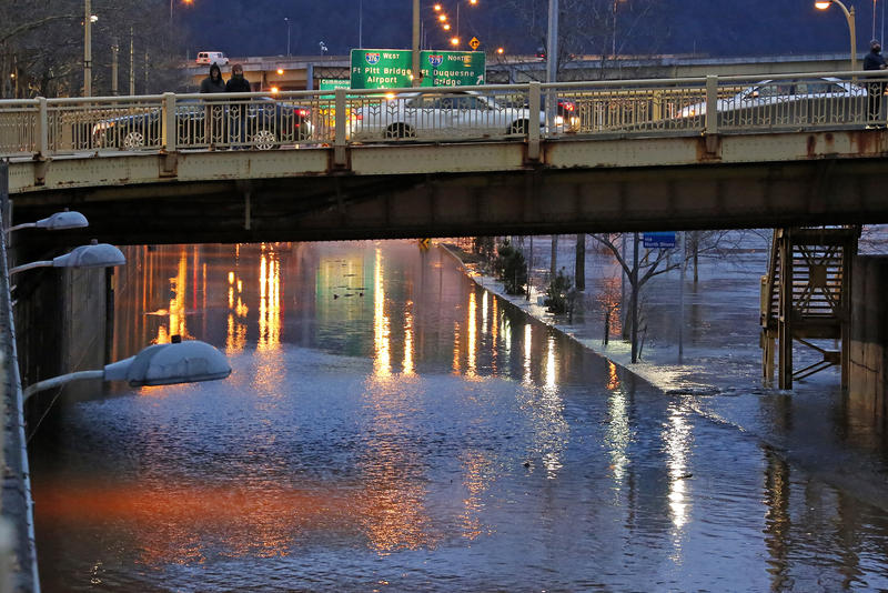 The Allegheny River overflows its banks, flooding Duquesne Boulevard in downtown Pittsburgh, Friday, Feb. 16, 2018.