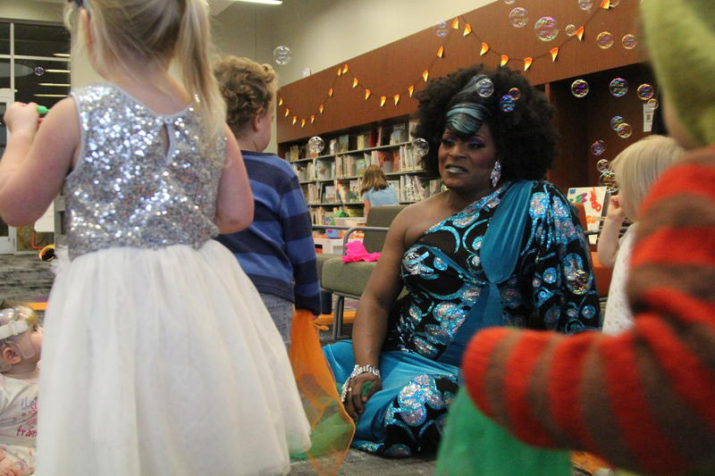 Akasha Lestat Van-Cartier talks to children after a drag story hour at the Carnegie Library's North Side branch on Saturday, Nov. 18, 2018.
