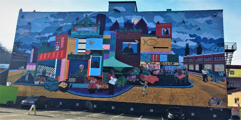 """The Strip Mural"" by artists Carley Parrish and Shannon Pultz shows the characters and longtime businesses associated with the historic food district."