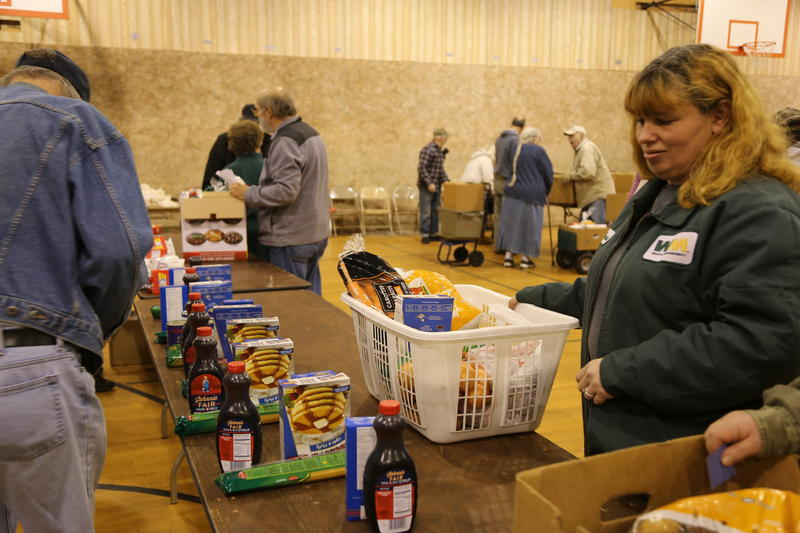 Volunteers assist in distributing mostly shelf stable items at a food pantry in Fayette County.