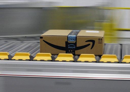 A box for an Amazon Prime customer moves through a fulfillment center Friday, Feb. 9, 2018, in Sacramento, Calif.
