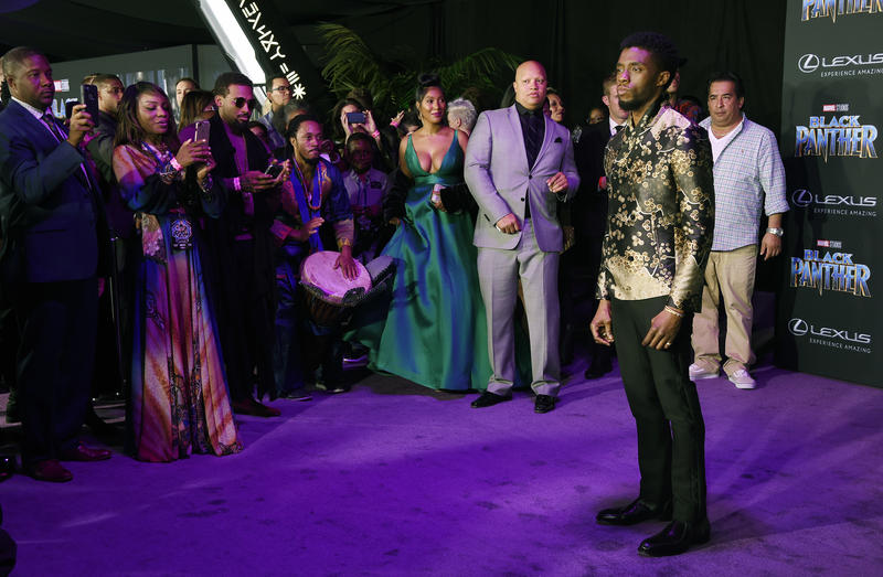 "Chadwick Boseman, right, star of ""Black Panther,"" is surrounded by onlookers as he poses at the premiere of the film at The Dolby Theatre on Monday, Jan. 29, 2018, in Los Angeles."