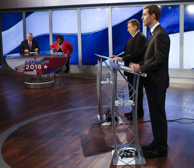 Republican Rick Saccone (second from right) and Democrat Conor Lamb (right) met for a second debate Saturday, Mar. 3, 2018, after an initial debate on Monday, Feb. 19, 2018.