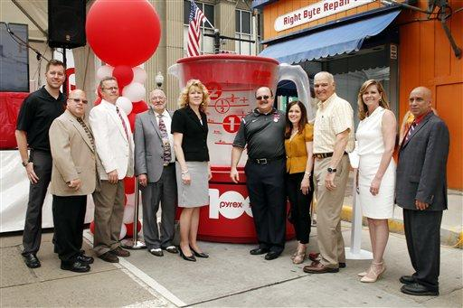 Washington County Commissioner Diana Irey Vaughan is pictured, center, yellow blouse, in this May 16, 2015 photo celebrating the 100th anniversary of the brand Pyrex in Charleroi, Pa.