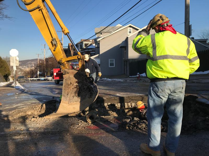 A crew works to repair a six-inch water main break on Penn Avenue in Lawrenceville on Jan. 19, 2018.
