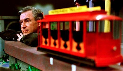 "Fred Rogers pauses during a taping of his show ""Mister Rogers' Neighborhood,"" in Pittsburgh in 1993. The show debuted 50 years ago today."