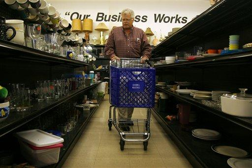 A man shops at a Goodwill store in Missouri. Local stores say they're having to deal with discarding people's broken and unwanted goods.