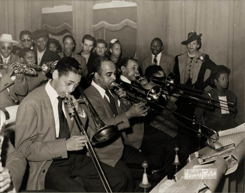 Billy Eckstine Orchestra performing with Eckstine on trombone on left, at Hill City Auditorium (Savoy Ballroom)