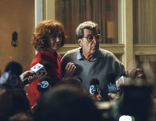 "In this image released by HBO, Kathy Baker, left, and Al Pacino portray Sue and Joe Paterno in a scene from ""Paterno,"" a film about the late Penn State football coach."