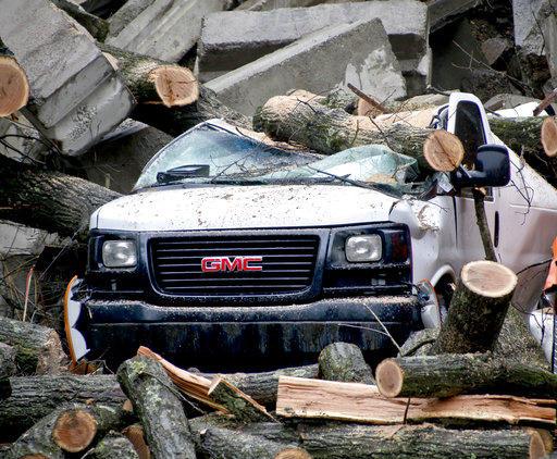 Debris surrounds a truck near a landslide in Millvale on Saturday, Feb. 24, 2018.
