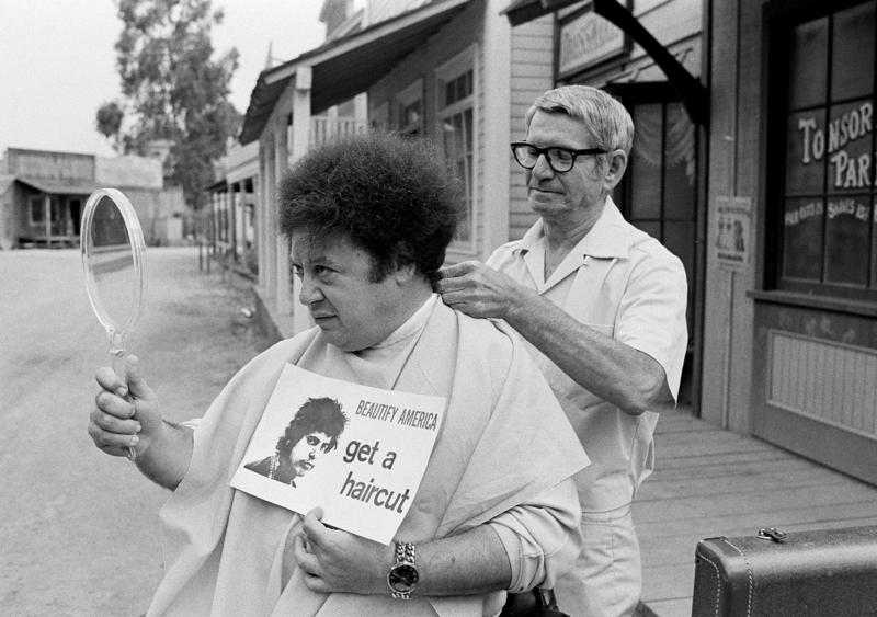 Comedian Marty Allen, fuzzy-haired member of the comedy team Allen & Rossi, has his hair styled by barber Sal Goldstein in Hollywood, Calif., on Aug. 15, 1968. His spokesperson confirmed his death at age 95 on Monday.