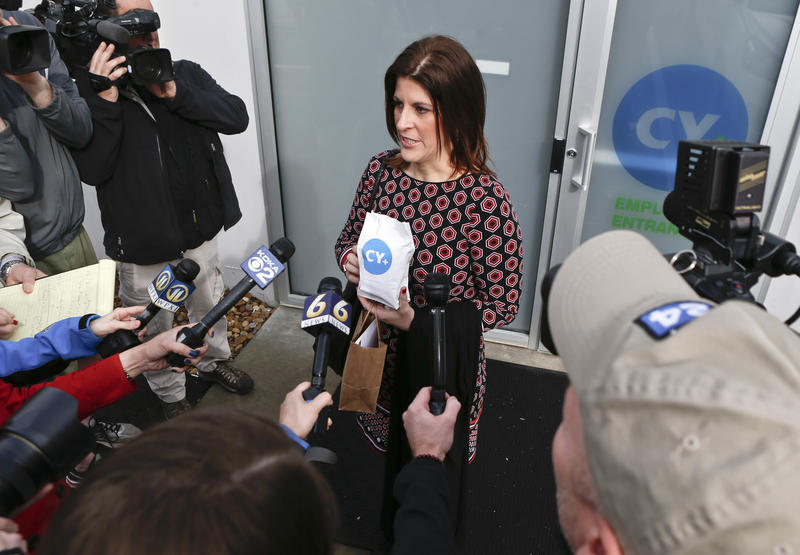 Heather Shuker, whose daughter Hannah suffers from intractable epilepsy, is surrounded by the media as she shows the bag containing the medicine she purchased at CY+ Medical Marijuana Dispensary, Thursday, Feb. 15, 2018 in Butler, Pa.