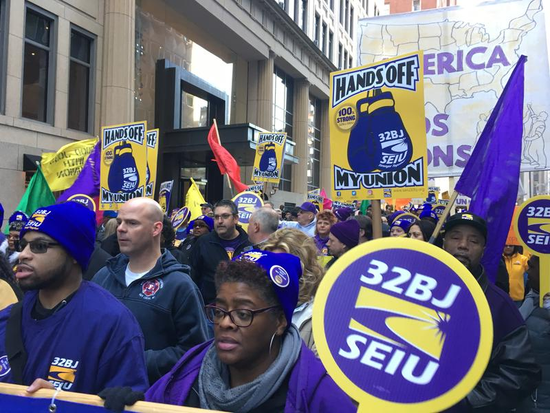 Marchers in downtown Pittsburgh Mon., Feb. 26, 2018, say they are protesting a lawsuit at the U.S. Supreme Court that could undo a rule that allows state and local governments to require non-union workers to pay partial union dues.