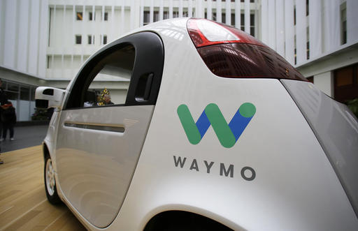 The Waymo driverless car is displayed during a Google event, Tuesday, Dec. 13, 2016. The company has reached a settlement with Uber over its self-driving technology.
