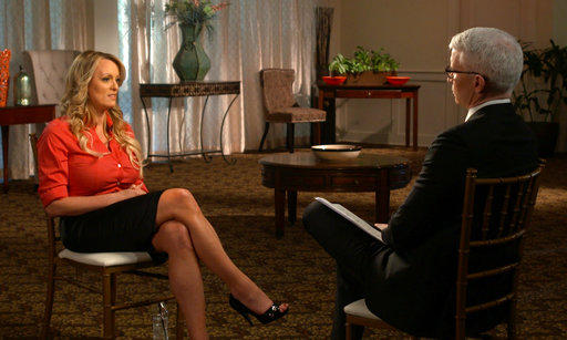 "This image released by CBS News shows Stormy Daniels, left, during an interview with Anderson Cooper which aired Sunday, March 25, 2018, on ""60 Minutes."""