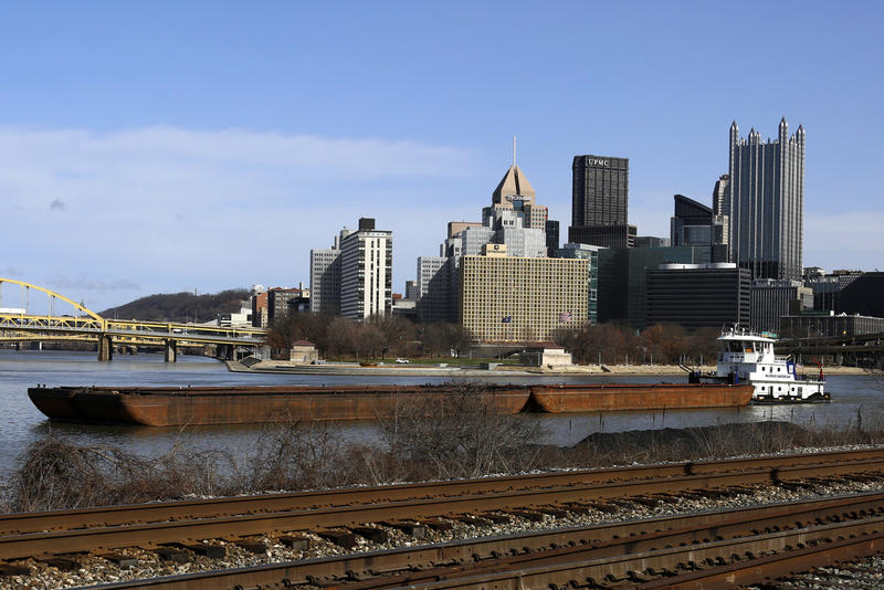 A barge is pushed down the Monongahela River in this March 2017 photo.