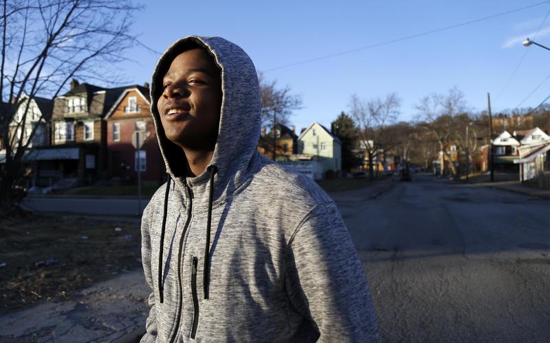 Maleeke Reid, 16, walks through Pittsburgh's Homewood neighborhood on Tuesday, Feb. 27, 2018.