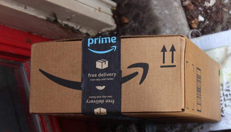A package outside a home on Pittsburgh's South Side on Tuesday, Feb. 20, 2018. Starting next month, Pennsylvania customers must pay sales tax on all purchases from online retailers like Amazon.
