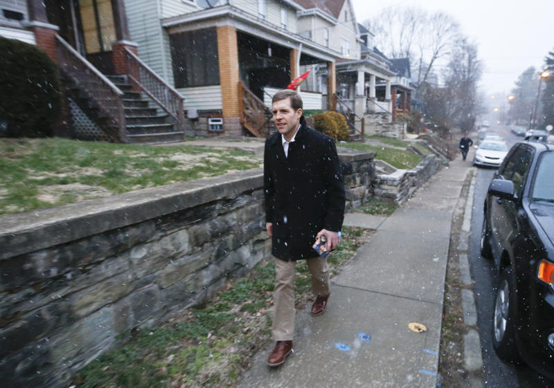 Democrat Conor Lamb knocks on the doors of prospective voters in the 18th Congressional District town of Carnegie on Wednesday, March 7, 2018.