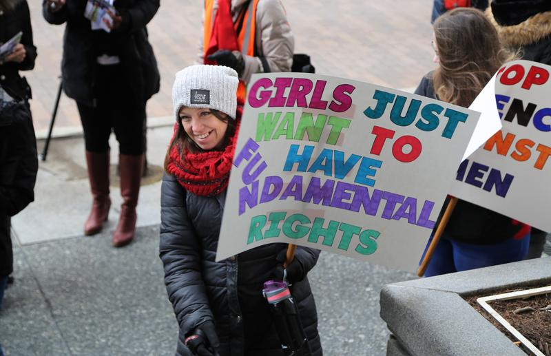 "A sign referencing the singer Cyndi Lauper's hit ""Girls Just Want To Have Fun"" was one of many homemade signs that participants carried throughout the demonstrations downtown on Thursday, March 8, 2018."