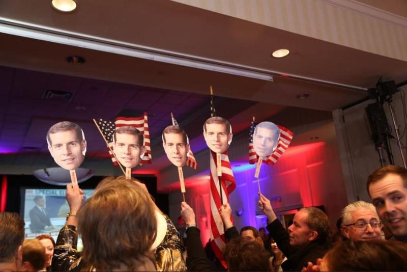 Conor Lamb supporters hold cutouts of the candidate's face while awaiting election results in the 18th Congressional District special election on Tuesday, March 13, 2018.