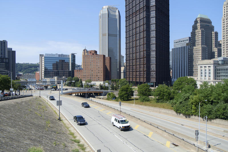 Traffic passes between Downtown Pittsburgh and the Hill District on Bigelow Boulevard and Interstate 579 on Wednesday, July 27, 2016.