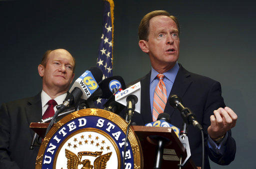 U.S. Sen. Pat Toomey, R-Pa., right, speaks during a press conference alongside U.S. Sen. Chris Coons, D-Del., Monday, March 5, 2018, in Philadelphia.