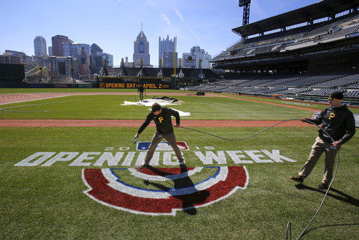 PNC Ground Crew Matt Brown, center, and Andy Burnette paint the field at PNC Park on Monday, March 26, 2018 in preparation for the home opener on Monday, April 2 against the Minnesota Twins in Pittsburgh.