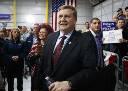 Republican Rick Saccone looks to the stage and President Donald Trump at a campaign rally at Atlantic Aviation in Moon Township, Pa., Saturday, March 10, 2018.