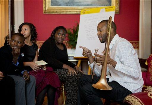 New Orleans musician Trombone Shorty, right, mentors a group of middle school students from the Washington area during an interactive student workshop in the Red Room of the White House in Washington, Wednesday, Oct. 14, 2015.