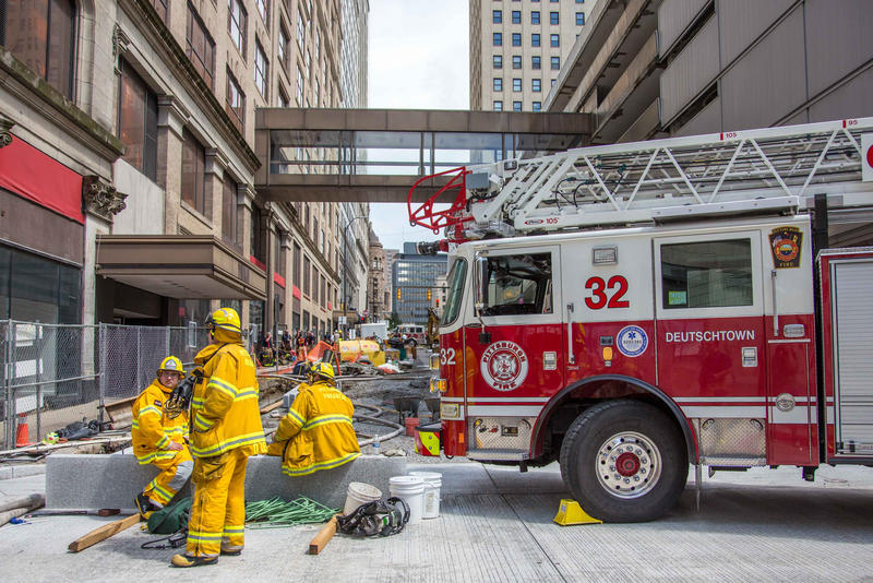 Pittsburgh firefighters work outside the former Macy's department store during a six-alarm fire in downtown Pittsburgh, Saturday, July 30, 2016.
