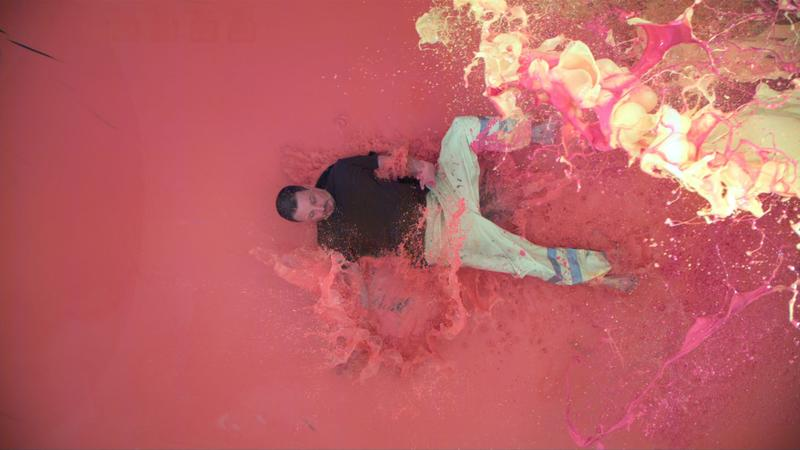 Artist David Ellis gets into his art in a 2008 performative work at the Mattress Factory on Pittsburgh's North Side.