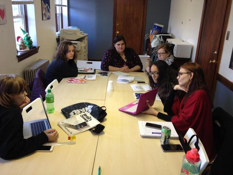 Girls work on their writing at a Girls Write Pittsburgh workshop.