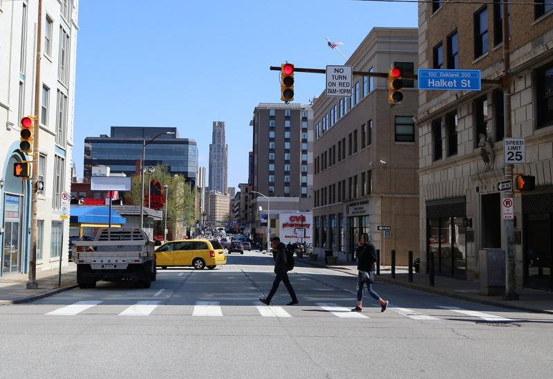 Pedestrians cross Forbes Avenue in Pittsburgh's Oakland neighborhoods in April 2017.