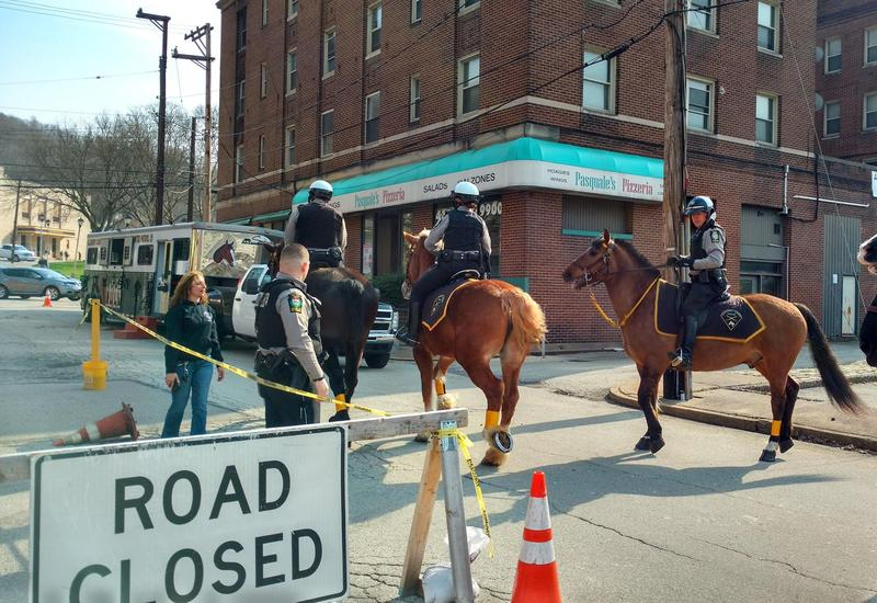 Mounted police units trot down Station Street in Wilmerding in a photo posted Tuesday, April 24, 2018, by the Allegheny County Police Department.