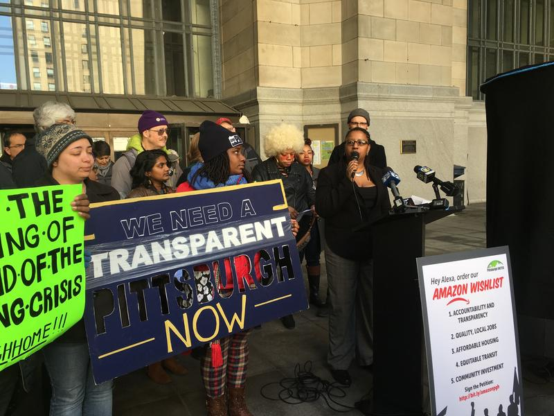 Activists call for a more transparent Amazon application process at a demonstration in Downtown Pittsburgh on Wednesday, April 11, 2018.