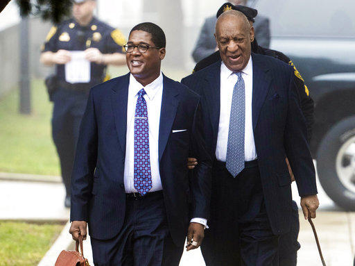 Bill Cosby, right, arrives for his sexual assault case Wednesday, April 4, 2018, in Norristown, Pa.