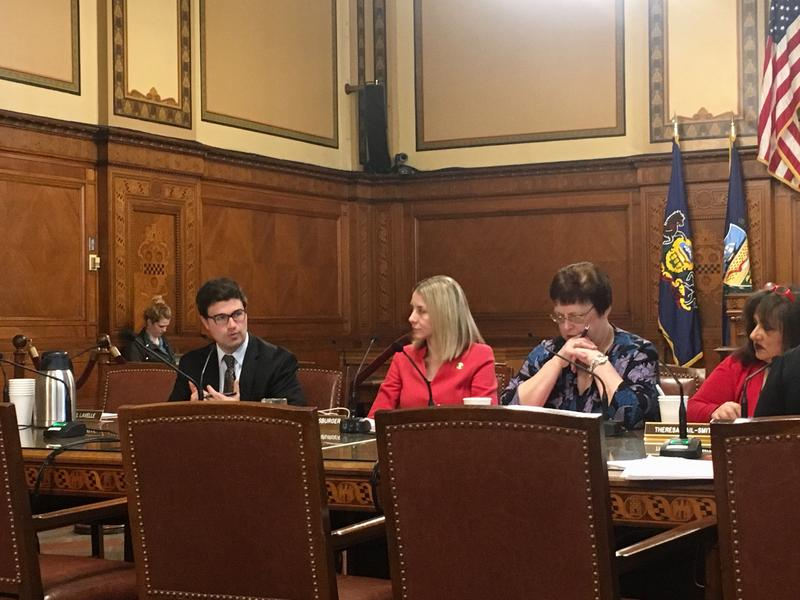 Pittsburgh City Councilor (left at table) has proposed a pilot program that would restrict 15 to 20 city-owned properties in Hazelwood to use as affordable housing.
