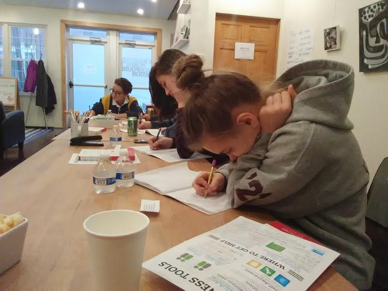 "Teens work on a prompt in the ""Writing Away The Stigma"" workshop at Pittsburgh's Creative Nonfiction Foundation in Garfield."